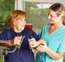 nurse assisting a patient to walk