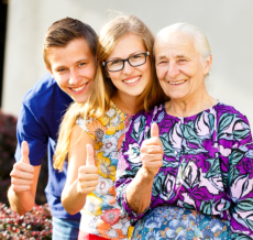 lady, man and old woman showing their thumbs up