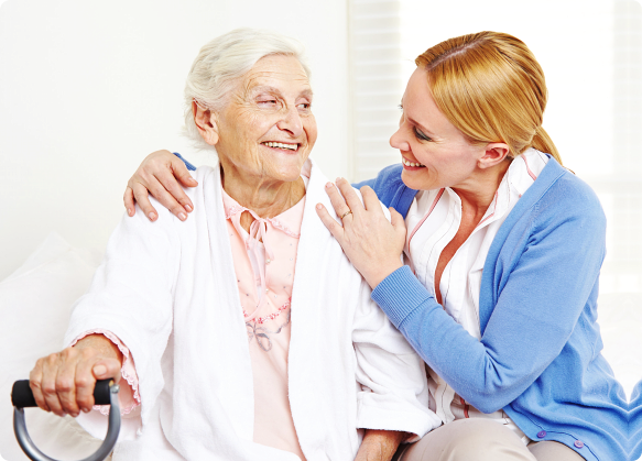 nurse and old woman smiling at each other