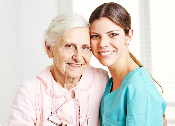 nurse and old man smiling while leaning at each other