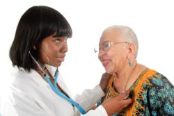 nurse checking patient's heartbeat